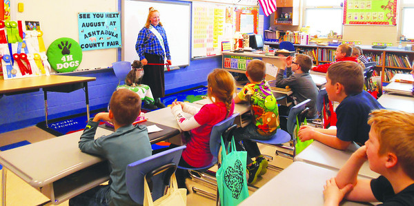 DEVASTASHA BEAVER / Star Beacon<br /> JUNIOR FAIR Princess, Hollie Dalton, 14, and her dog, Gunny visited third, fourth, and sixth grade classrooms at Rock Creek Elementary on Tuesday to talk about 4-H clubs and dog-training.