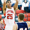 WARREN DILLAWAY / Star Beacon<br /> JAMES JACKSON (25) of Jefferson prepares to shoot over  Austin Hogan (24) of Austintown Fitch on Tuesday at Jefferson.