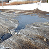 WARREN DILLAWAY / Star Beacon<br /> STORM WATER drainage has caused a perpetual sink hole along West 58th Street in Ashtabula.