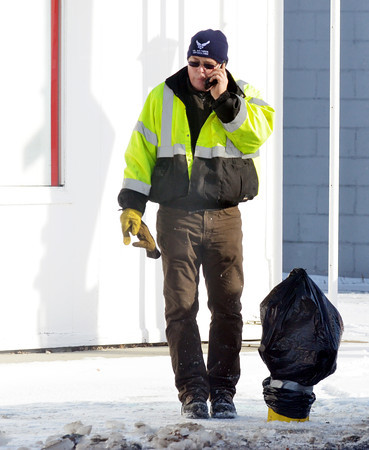 WARREN DILLAWAY / Star Beacon<br /> ED SPOOR, superintendent of the Ashtabula County Environmental Services, attempts to solve a leaky fire hydrant on the Strip in Geneva-on-the-Lake on Friday morning.