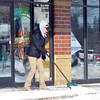 WARREN DILLAWAY / Star Beacon<br /> ASHLEY CLUNK, sandwich artist at the Geneva Subway, shovels snow in front of the store on Friday morning.