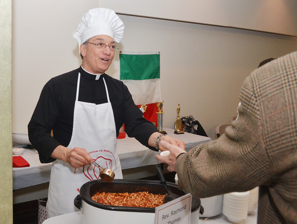 WARREN DILLAWAY / Star Beacon<br /> REV. RAYMOND THOMAS serves pasta fagioli during the Men Who Cook event on Saturday night at Our Lady of Peace Community Center in Ashtabula. The event is a fund raiser for Catholic Charities to help the needy of Ashtabula   County.
