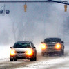 WARREN DILLAWAY / Star Beacon<br /> MOTORISTS NAVIGATE a snowy Main Avenue on Saturday afternoon in Ashtabula.