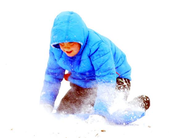 WARREN DILLAWAY / Star Beacon<br /> ALEX DOING, 10, of Ashtabula spins down a hill at Lake Shore Park on Saturday morning in Ashtabula Townhip.
