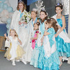 WARREN DILLAWAY / Star Beacon<br /> LILLY ANN AKOS, 2, of Madison, (lower left) reaches for a trophy as Winterfest Pageant royalt gather for a photograph on Saturday night at the Geneva Community Center.