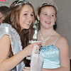 WARREN DILLAWAY / Star Beacon<br /> CASSIDY BRUINSMA (left) smiles after being crowned Junior Miss Winterfest  Saturday night at the Geneva Community Center with outgoing Young Miss Winterfest Karlie Bradbury.