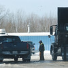 WARREN DILLAWAY / Star Beacon<br /> A TRUCKER is silhouetted between trucks at the Harpersfield Township Kwik Full on Thursday afternoon.