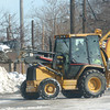 WARREN DILLAWAY / Star Beacon<br /> GENEVA CITY crews work on snow removal on Thursday afternoon along Depot Street where Winterfest will be held on Saturday.