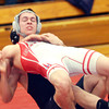 WARREN DILLAWAY / Star Beacon<br /> JACOB CORDONA of Edgewood (facing) falls to the mat on Thursday night during a 152 pound match with Mason Swiney of Jefferson  at Edgewood. Josh Ebbert officiated the match.