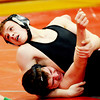 WARREN DILLAWAY / Star Beacon<br /> CHRISTIAN SAUNDERS (top) of Jefferson goes for the pin on Thursday night during a 160 pound match with Joseph Scarpetti of Edgewood