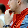WARREN DILLAWAY / Star Beacon<br /> MATT VESPA, Geneva boys basketball coach, watches the action on Friday night during a home game with Eastlake North.