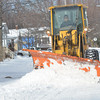 WARREN DILLAWAY / Star Beacon<br /> AN ASHTABULA snow plow clears snow along Thayer Avenue on Friday afternoon.