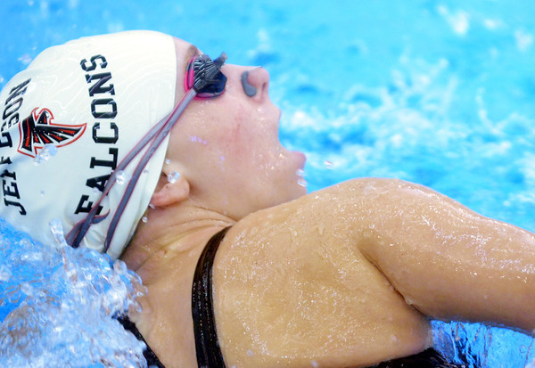 WARREN DILLAWAY / Star Beacon<br /> LAUREN BUZZARD of Jefferson takes a breath during the 400 freestyle relay at the Belva J. Boone Ashtabula County Swim Meet at Spire Institute on Saturday.