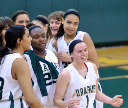 """WARREN DILLAWAY / Star Beacon<br /> KRISTEN KEASLING (1) and Lakeside teammates Brianna Scruggs (left foreground) and Shy""""Questa Pollard (23) celebrate after winning a home game against Riverside."""