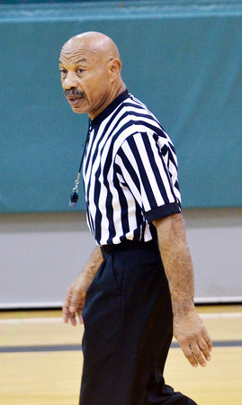 WARREN DILLAWAY / Star Beacon<br /> CHUCK REILLY officiates the Riverside at Lakeside girls basketball game on Saturday at Lakeside.