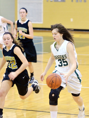 WARREN DILLAWAY / Star Beacon<br /> SARAH MOREHOUSE (35) of Lakeside dribbles up court with Jess Kovalchuk (22) in hot pursuit on Saturday at Lakeside.