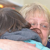 WARREN DILLAWAY / Star Beacon<br /> BETH KOSKI (facing) receives a hug during her retirement reception at the Ashtabula Arts Center. She was director of the arts center for 28 years.