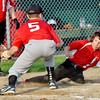 WARREN DILLAWAY / Star Beacon<br /> MIKE HAMSKI of the Jefferson Major League All Star team slides safely home as David Stewart of Perry prepares to  apply a late tag on Tuesday at Havens Complex in Jefferson Township.