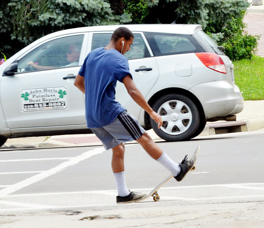 WARREN DILLAWAY / Star Beacon<br /> ROLAND GOOD of Ashtabula comes to a stop while skateboarding in Ashtabula Harbor.