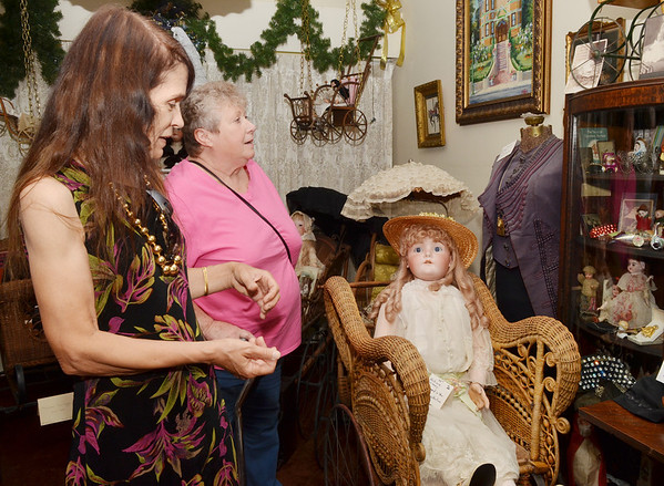 WARREN DILLAWAY / Star Beacon<br /> JUDY KAMINSKI gives Theresa Koehler of Austintown a tour of the Victorian Perambulator Museum on Saturday during the 25th anniversary celebration in Jefferson. Kaminski started the museum a quarter of a century ago with her sister Jan Pallo.