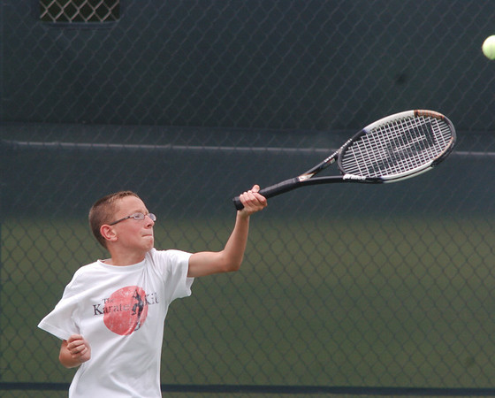 WARREN DILLAWAY / Star Beacon<br /> ISAAC PALINKKAS of Geneva plays his twin brother Nathan during the Ashtabula County Tennis Championship 12 and under match on Saturday in Geneva.