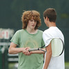 WARREN DILLAWAY / Star Beacon<br /> BRIAN SEEDS (left), a freshman at Geneva, shakes hands with Ben Gruber, a sophomore at Geneva, during a consolation final of the 15 and under category of the Ashtabula County Tennis Championship.
