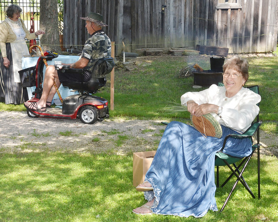 """WARREN DILLAWAY / Star Beacon<br /> JANE WILSON creates baskets from marsh grass during the Early America """"Live"""" 1890 Re-Enactment at the Historic Depot Village in Jefferson."""