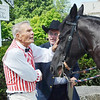 """WARREN DILLAWAY / Star Beacon<br /> JIM DUTTON (left), manager of the general store at the Historic Jefferson Depot Village, and Rev. Vernon Palo, circuit riding preacher, chat before Palo mounted the horse on Saturday during Early America """"Live"""" 1890 Re-Enactment on Saturday."""