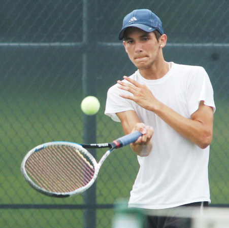 WARREN DILLAWAY / Star Beacon<br /> JOSH EDWARDS, 15, of Conneaut, competes in the 18 and under division of the Ashtabula County Tennis Championships at Geneva on Saturday.