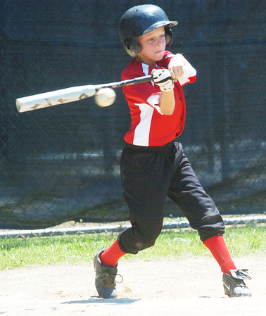 WARREN DILLAWAY / Star Beacon<br /> TYLER ALEXANDER of the Ashtabula Major League All Stars takes a mighty swing on Saturday during District 1 Championship action against Ashtabula at Cederquist Park.