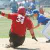 WARREN DILLAWAY / Star Beacon<br /> JACOB JOHNSON of Jefferson slides safely into second base as Zacg Griffith of Ashtabula reaches for the ball during District 1 championship action at Cederquist Park on Saturday.