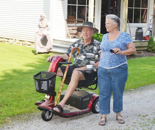 """WARREN DILLAWAY / Star Beacon<br /> AL AND BOBBIE Reese of Leesburg, FL., enjoy a trip back to the 1890's Saturday during  Early America """"Live"""" t the Historic Jefferson Depot Village. The event continues today at noon."""