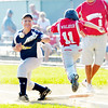 WARREN DILLAWAY / Star Beacon<br /> WILL WALKER of the Ashtabula Minor League All Stars arrives safe at first base as Conneaut first baseman Jacob Wiley attempts to field the ball on Monday evening at Cederquist Park in Ashtabula.
