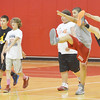 WARREN DILLAWAY / Star Beacon<br /> BRANDON DELIA (far right) and fellow Geneva Basketball Camp participants warm-up on Tuesday morning.