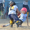 WARREN DILLAWAY / Star Beacon<br /> LEXI ZEMAN of the Ashtabula Minor League All Stars slides home as Tera Myers of Conneaut prepares to tag her out on Tuesday at Cederquist Park in Ashtabula.