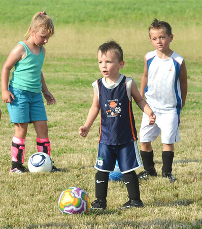 WARREN DILLAWAY / Star Beacon<br /> GABE WILLIAMS, 3, (center foreground) reacts to a whistle during the Jefferson Soccer Camp with Kassidy Blood, 6, and Josh Hernan, 5, in the background on Tuesday evening in Jefferson.