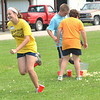 WARREN DILLAWAY / Star Beacon<br /> KASSIDY BRINKER, 12, of Rock Creek, participates in a popcorn relay race on Tuesday during the 4H Dairy Camp at the Ashtabula County Fairgrounds in Jefferson.