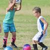 WARREN DILLAWAY / Star Beacon<br /> JOSH HERNAN, 5, (right) and Kassidy Blood, 6, react to the ball during the Jefferson Soccer Camp on Tuesday evening in Jefferson.
