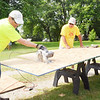 WARREN DILLAWAY / Star Beacon<br /> JEFF MYERS (left) and Bill Wiley, both of Conneaut, work on a roofing project on Lakeview Avenue in Conneaut. The Loving Equally All Families volunteers are working on 50 projects throughout the city.