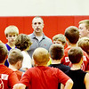 WARREN DILLAWAY / Star Beacon<br /> MATT VESPA, the newly hired Geneva boys basketball coach, interacts with campers during the Geneva Basketball Camp on Tuesday at Geneva High School.