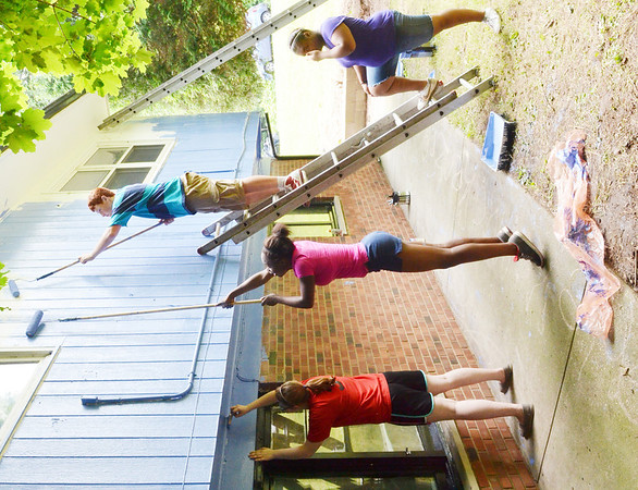 WARREN DILLAWAY / Star Beacon<br /> LOVING EQUALLY All Families volunteers (from left) Ashley Stowers, 15, Alicia Colbert, 14, Vince Ballard, 14 and Alexea Colbert work on a painting job on Detroit Avenu e in Conneaut.