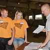 WARREN DILLAWAY / Star Beacon<br /> TOM UBER (right) conducts a dairy seminary as Craig Butler (left) of Denmark Township and Morgan Holloman, 18, of Kingsville Township, listen on Tuesday during Dairy Camp at the Ashtabula County Fairgrounds.