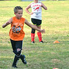 WARREN DILLAWAY / Star Beacon<br /> LUKE HERNAN, 8, (foreground) and Veronica Forman, 12, participate in a drill during Jefferson Soccer Camp on Tuesday evening in Jefferson.