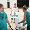 WARREN DILLAWAY / Star Beacon<br /> TAMMY STOKES, a Dairy Camp helper, (facing with sign) gives a penalty to dairy camper Terea Polchin, 13, of Williamsfield, as Megan Christo, 12, of Jefferson (left) watches on Tuesday at the Ashtabula Fairgrounds in Jefferson.