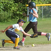 WARREN DILLAWAY / Star Beacon<br /> EMILY LORELLO (foreground) of the Conneaut Minor League All Stars tries to field a throw as Kayla Lindberg runs to third during a District 1 championship game at Carraher Field in Geneva on Thursday evening.