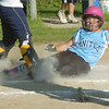 WARREN DILLAWAY / Star Beacon<br /> KYLIE SHAUGHNESSY of Geneva United Minor League All Stars is forced out at home during a District 1 championship game against Conneaut at Carrager Field in Geneva.