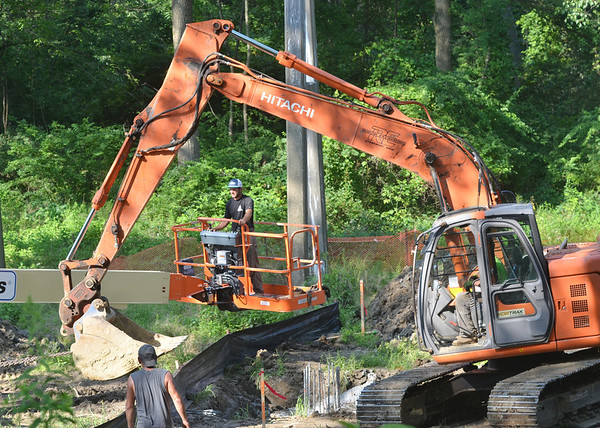 WARREN DILLAWAY / Star Beacon<br /> CONSTRUCTION ON a new sanitary sewer lines is moving along near the intersection of Chestnut Street and Lake Road in Conneaut.