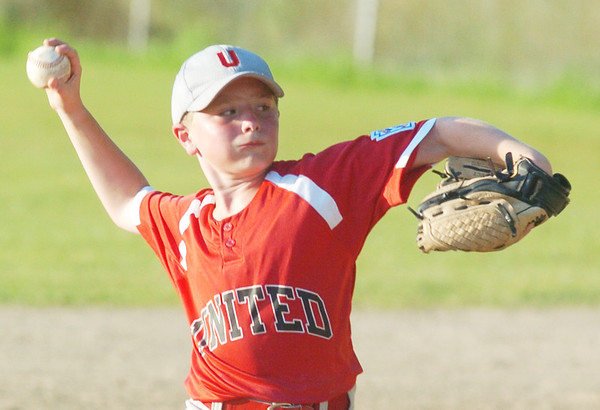 WARREN DILLAWAY / Star Beacon<br /> WYATT FUDURIC of Geneva pitches for the Geneva United Minor League All Stars on Thursday during a District 1 championship game against Conneaut at Carraher Field in Geneva.