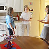 WARREN DILLAWAY / Star Beacon<br /> SARAH MASEK, housing director at the Ashtabula Beatitude House, talks with Lorna Greicius (center) and resident Bunny Cavallaro (left) on Friday during an open house celebrating the one year anniversary of the organization that helps women get on their feet.