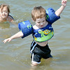 WARREN DILLAWAY / Star Beacon<br /> PARKER SMITH, 2, of Erie, tries to walk in Lake Erie at Lake Shore Park beach on Friday afternoon.